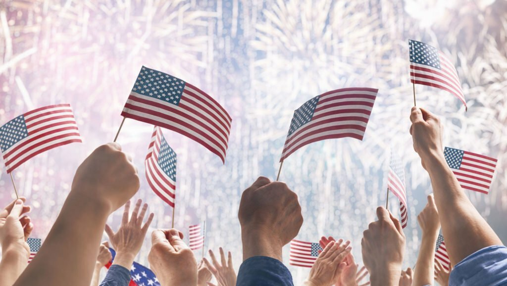 Peoples-Hands-Holding-US-Flags