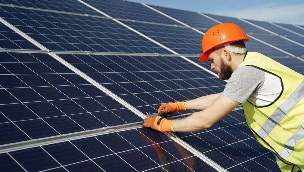 Employee-Installing-Solar-Panels